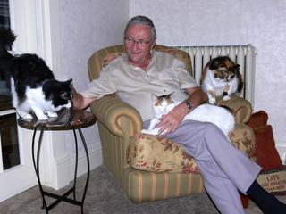 Man with three cat's.