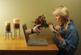 Online dating concept. Hand & Wine Glass Through Laptop Screen poster