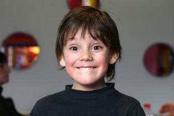 petit garçon qui sourie