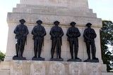 monument.statues of soldiers holding guns & regimental badges poster