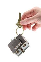 Hand holding house keys on key ring