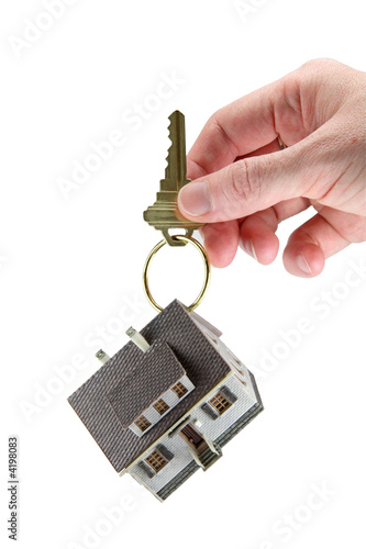 Hand holding house keys on key ring