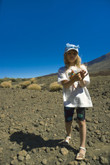 Girl on rim of volcano caldera