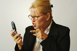 Business woman expresses her anger while on her cell phone. poster