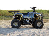 Small All Terrain Vehicle on a beach poster