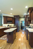 trendy custom kitchen with cherry cabinets poster