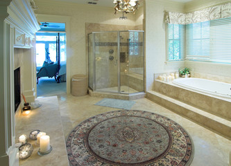 opulent bathroom with whirlpool and fireplace