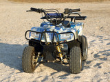 Small All Terrain Vehicle on a beach 2 poster