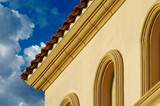 Abstract of New Stucco Wall Construction, Windows & Clouds poster