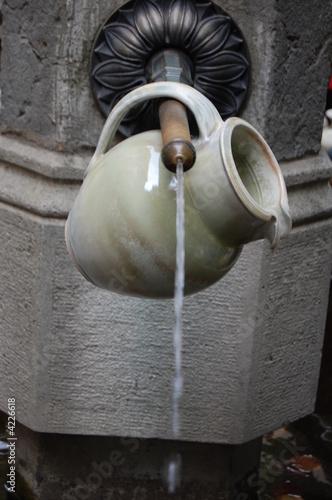 Leinwandbild Motiv Wasser holen