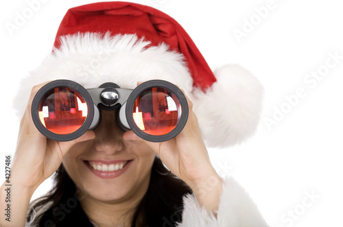 female santa with binoculars