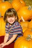 Girl in Pumpkin Patch poster