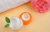 Bathroom still-life - Moisturizing face cream with  towel poster