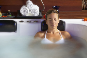 beautiful young woman relaxing in spa