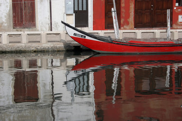 Reflex of a Red Boat