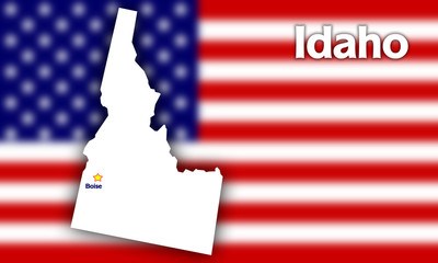 Idaho state contour with Capital City against blurred USA flag