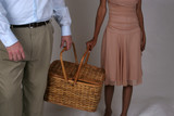 interracial couple hold a picknick basket poster