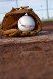 Baseball & Glove on Baseball Field
