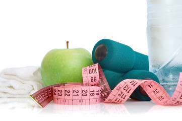 Dumbells, apple and measuring tape