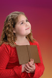 Girl, holding book, reflecting on what she has read poster