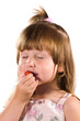 Little girl tasting strawberry