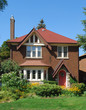 Small red brick two storey house