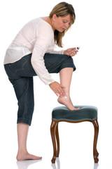 Lady in rheumatic pain give herself leg masssage