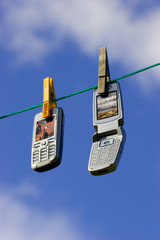 Two cell phones Part of Global Mobile phone network