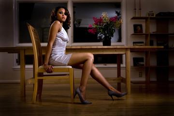 woman sitting in evening dress