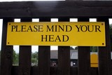 sign. please mind your head poster