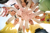 team with joined hands