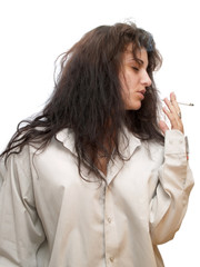 woman standing in man shirt and smoking