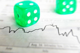 Closeup of dice on a stock market graph