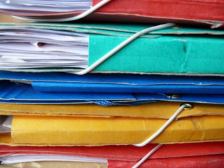 Pile of colorful, paper, cardboard office files and paperwork
