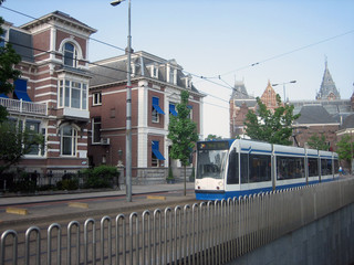 A view of a Train as it passes the Rijksmuseum