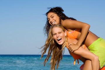piggyback fun, happy smiling beautiful healthy,teens
