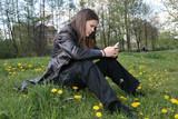 Teenage girl sending an sms poster