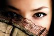 Quadro female eyes behind fan