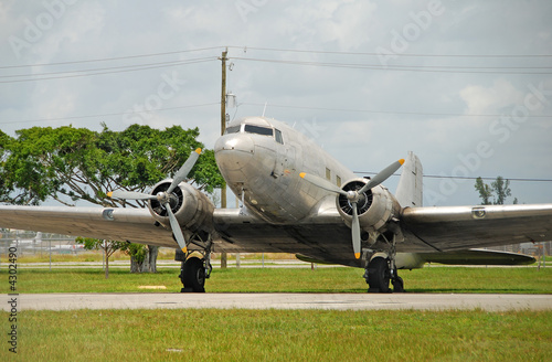 Classic DC-3 airplane parked on the ground