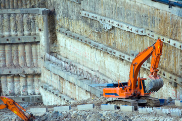 Construction site. Excavator in construction pit.