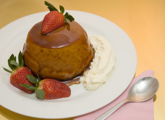 caramel sponge pudding aligned left with gold background