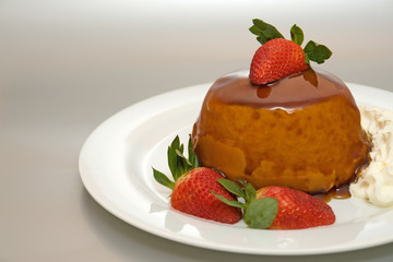 caramel sponge pudding on silver background