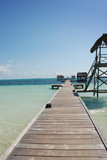 Endless pier scene over beautiful blue ocean horizon poster