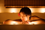 Beautiful Chinese girl with short hair gazes into candle poster