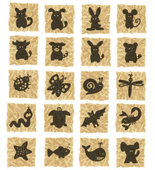 animals icons on crumpled paper