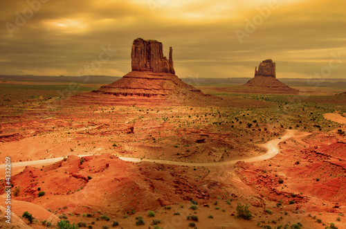Sunrays through clouds at sunset, Monument Valley