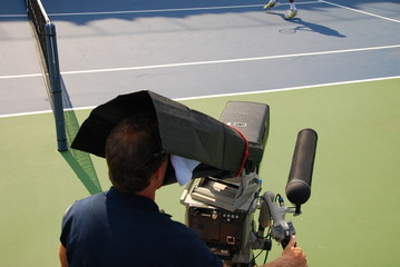 filming a tennis match