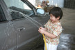 Kid washing car