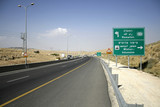 road sign going down to the dead sea region poster