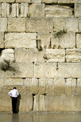 man praying next to the wailing wall, jerusalem,israel